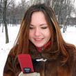 The girl in the winter in park with phon — Stock Photo