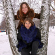 Two girls in the winter in park — Stock Photo