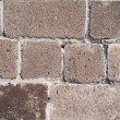 Old wall from a rough grey brick. backgr — Stock Photo
