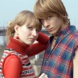 Stockfoto: Young couple - the guy and the girl outd