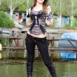 Beautiful girl standing on a mooring — Stock Photo