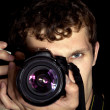 The young man - photographer behind work — Stock Photo