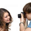 Photographer taking pictures of the youn — Stock Photo