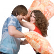 The young couple fights pillows. Isolate — Stock Photo