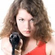 Stock Photo: Young womwith pistol. Isolated on w