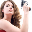 Young woman with a revolver. Isolated on — Stock Photo