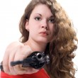 Young woman with a revolver. Isolated on — Stock Photo #1106282