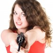 Young woman with a revolver. Isolated on - Stock Photo