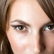 Eyes of the young beauty woman — Stock Photo