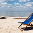 Stock Photo: Chair on beach against gulf and clou