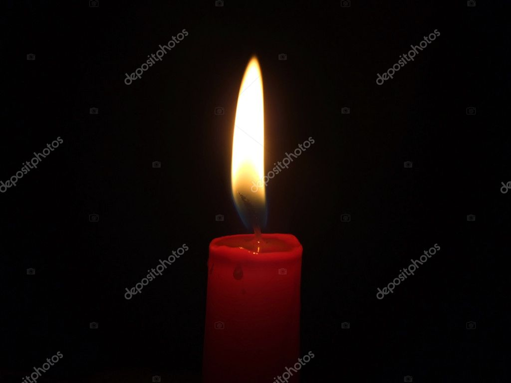 The red candle burning in full darkness — Foto Stock #1104205