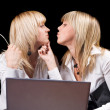 Royalty-Free Stock Photo: Two kissing businesswomen with laptop. I