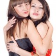 Two embracing beauty young women. Isolat — Stok fotoğraf
