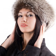 Portrait of the young woman in a fur cap — Stock Photo