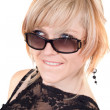 Royalty-Free Stock Photo: The blonde in sunglasses with a crafty s
