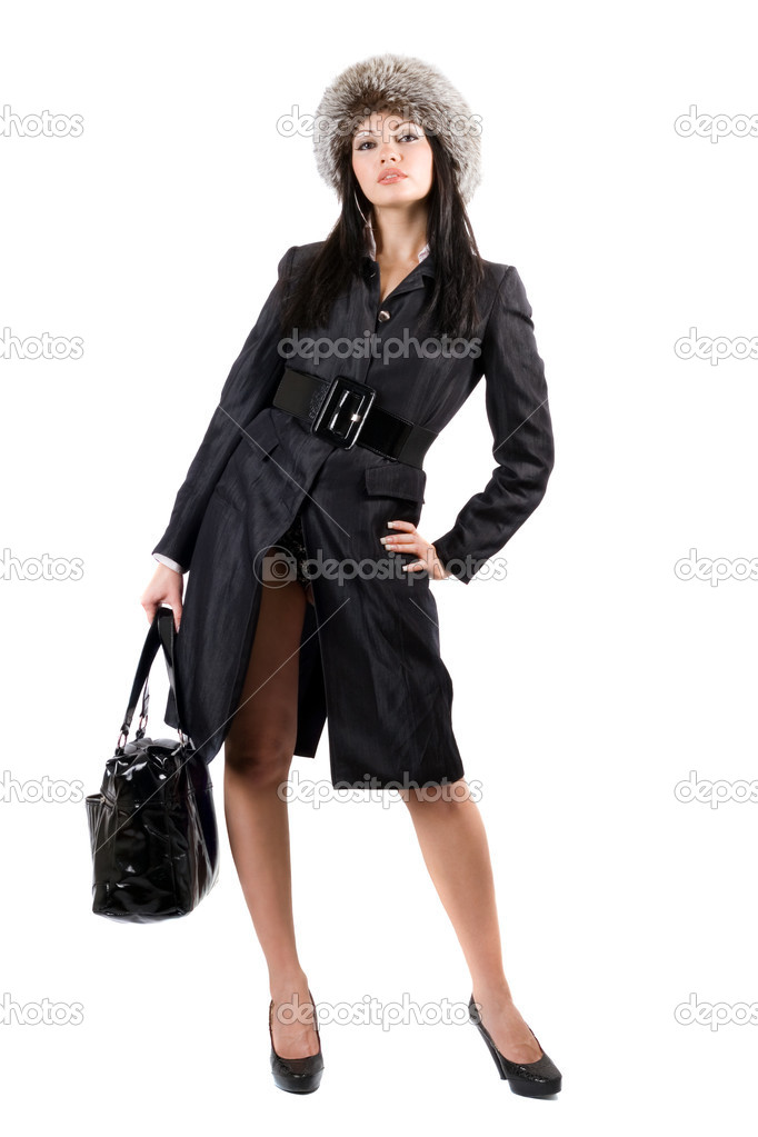 The young woman in a black coat and a fur cap. Isolated — Stock Photo #1159492