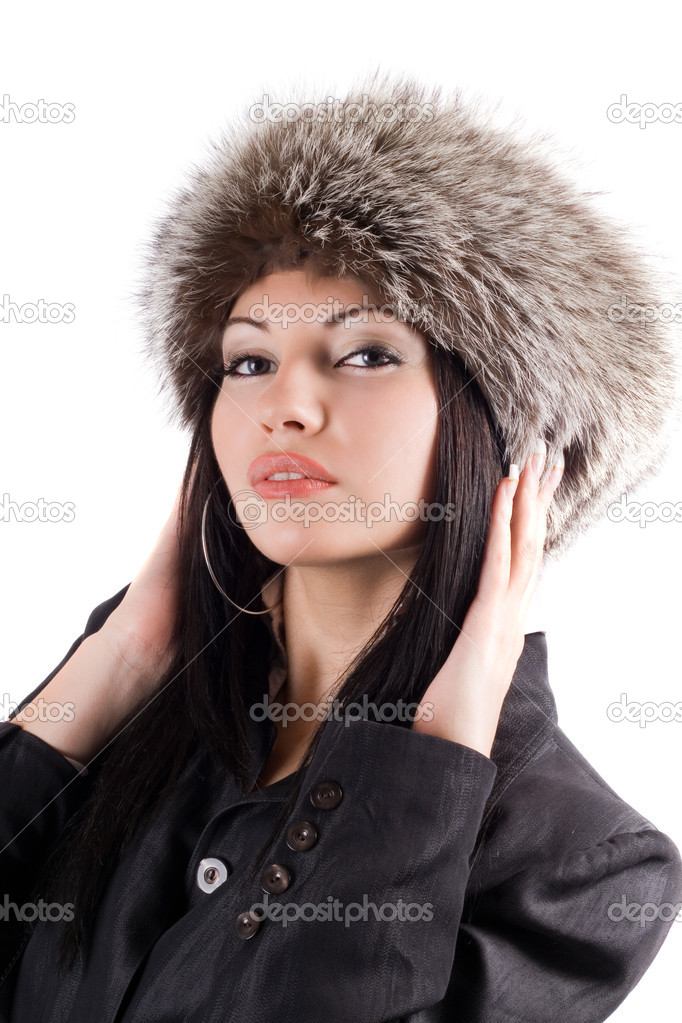 Portrait of the young woman in a fur cap. Isolated — Stock Photo #1159513