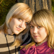 Portrait of the two young women outdoors — Stock Photo