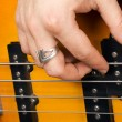 Hand of the guitarist on guitar strings — Stok fotoğraf