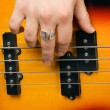 Stock Photo: Hand of artist on guitar strings