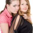 Stock Photo: Two pretty young women. Isolated on whit