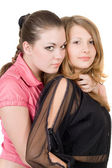 Two pretty young women. Isolated on whit — Stock Photo