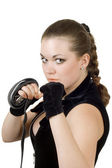 Pretty angry young woman throwing a punc — Stock Photo