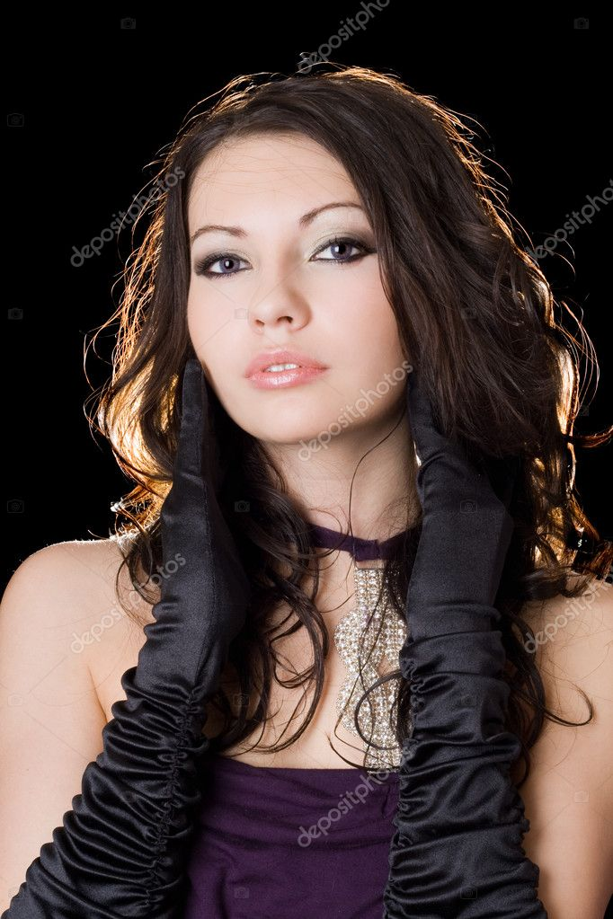 Lovely young woman in a violet dress over black  Foto Stock #1166572