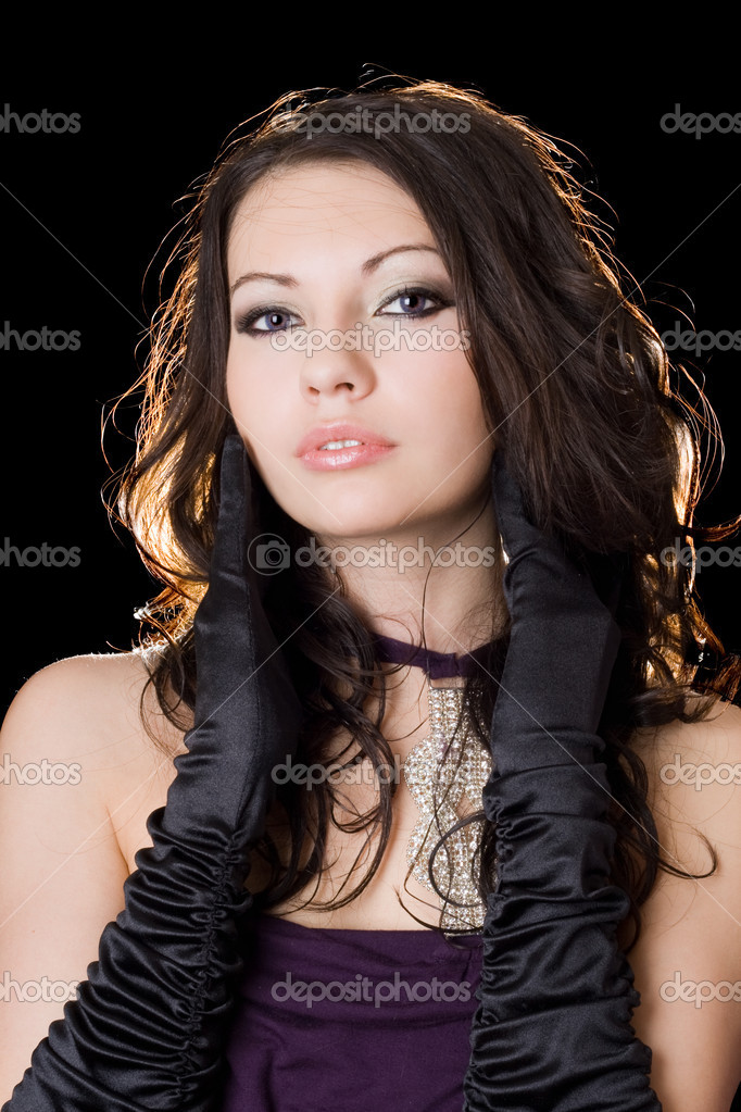 Lovely young woman in a violet dress over black — Stockfoto #1166572