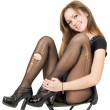Smiling pretty girl in the torn stocking — Stock Photo