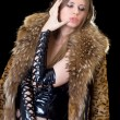 Young lady in latex suit and a fur coat — Stock Photo