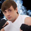 Portrait of the young fighter in a smoke — Stock Photo