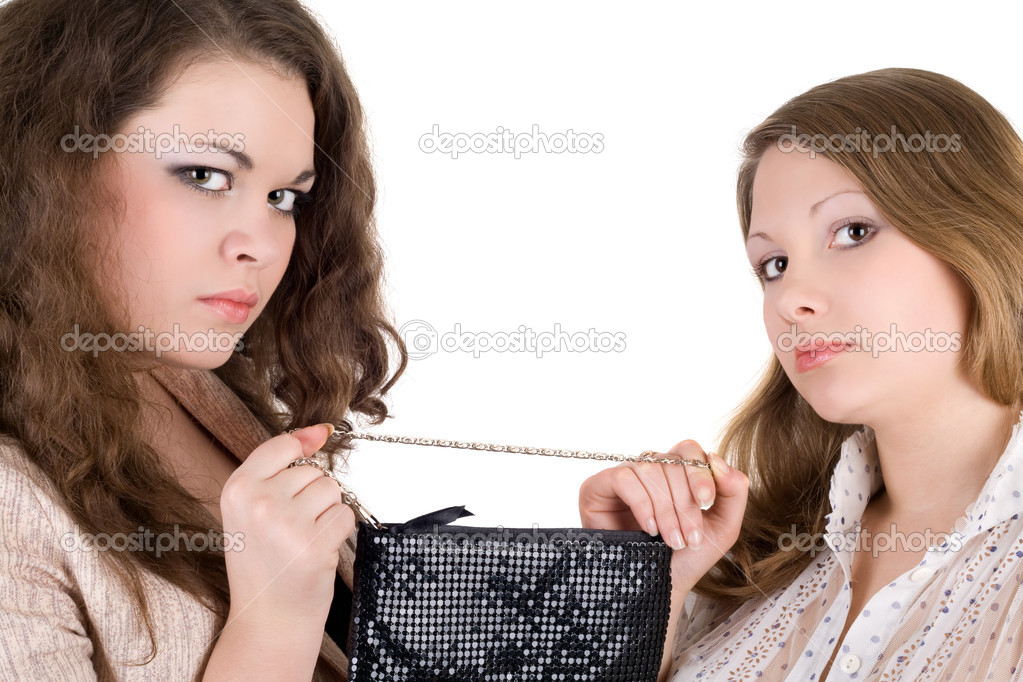 Quarrel of two beautiful girls because of a handbag — Stock Photo #1209401
