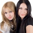 Portrait of the two pretty smiling girlf - Stockfoto