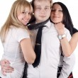 Foto Stock: Young man and two young women. Isolated