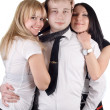 图库照片: Young man and two young women. Isolated