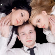Portrait if the young man and two pretty — Stock Photo