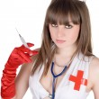 Portrait of the sexy nurse with a syring — Stock Photo #1211745