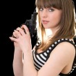 Stock Photo: Attractive young woman with pistol. Isol