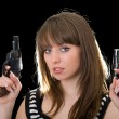 Attractive young woman with two pistol. - Stock Photo