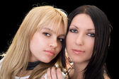 Portrait of the young brunette and blond — Stock Photo