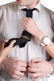 Young man, a tie and female hands. Isola — Stock Photo