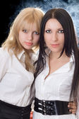 Portrait of the young brunette and blond — Stok fotoğraf