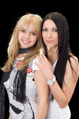 Portrait of the young brunette and blond — Stockfoto