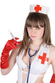 Portrait of the sexy nurse with a syring — Stock Photo