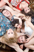 Three young women and two young men — Stock Photo
