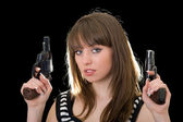 Attractive young woman with two pistol. — Stock Photo