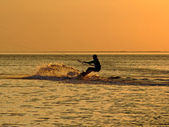Silhouette of a kitesurf on a gulf on a — ストック写真