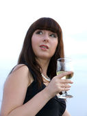 The girl with a glass of white wine — Stock Photo