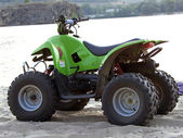 Small All Terrain Vehicle on coast of th — Stock Photo